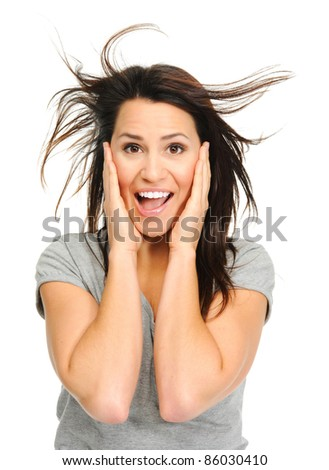 Pretty woman is excited with windswept hair - stock photo