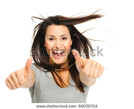 Pretty woman is jubilant with windswept hair  and thumbs up - stock photo