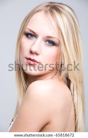 Pretty woman looking at camera - stock photo