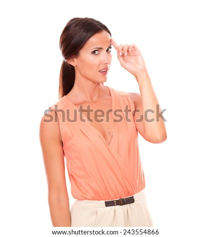 Pretty woman looking at you wondering about a question while standing in white background - copyspace - stock photo