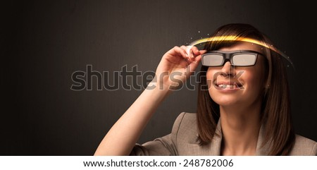 Pretty woman looking with futuristic high tech glasses concept - stock photo