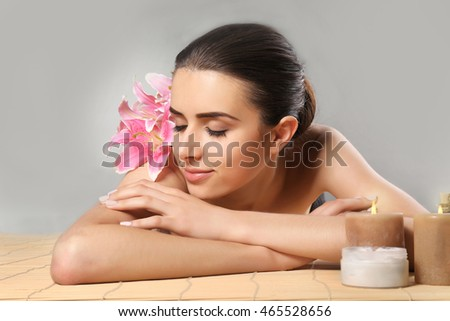 Pretty woman lying on table