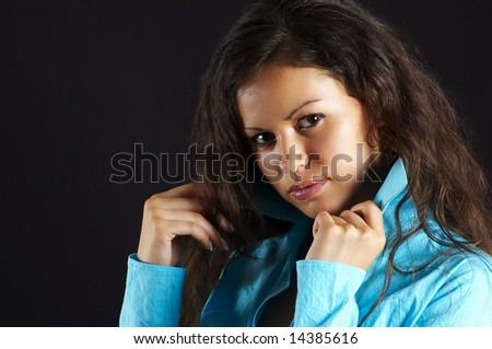 pretty woman of the brunette, on black background (closeup) - stock photo