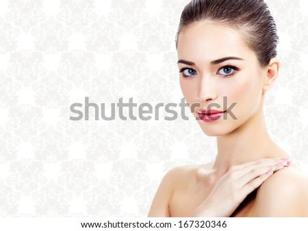 pretty woman on a classic rococo background  - stock photo