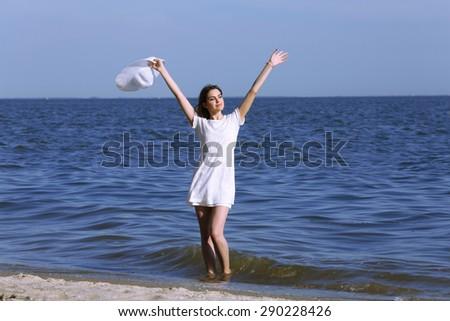Pretty woman on beach - stock photo