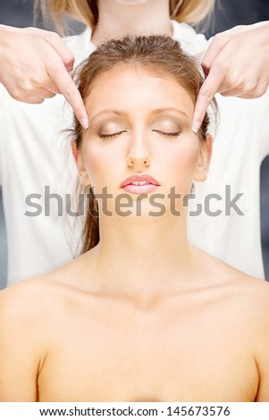 Pretty woman on head massage treatment