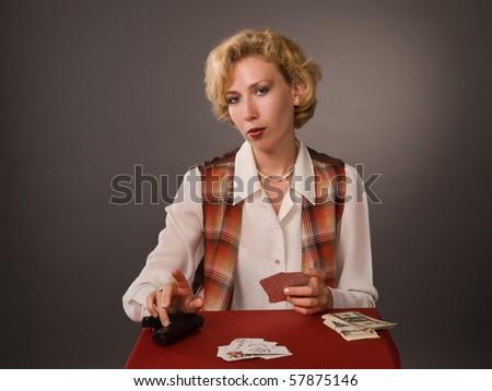 Pretty woman play poker - stock photo