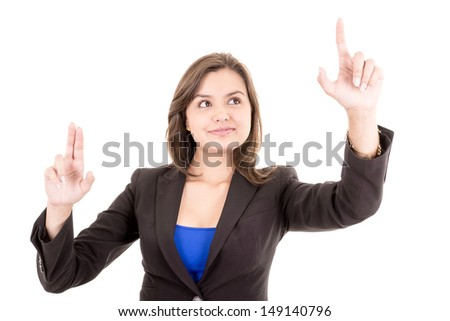 Pretty woman pointing at something in the air - stock photo