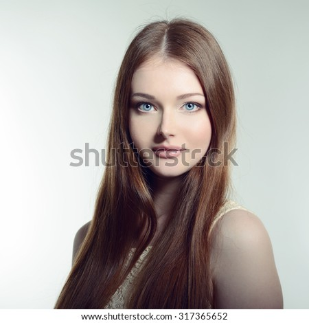 Pretty woman. Portrait of young attractive woman. Image toned. - stock photo