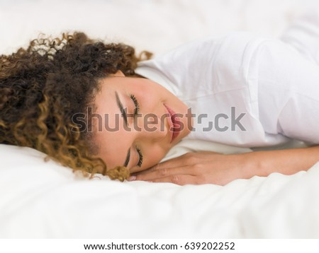 Pretty woman portrait smiling while sleeping soundly