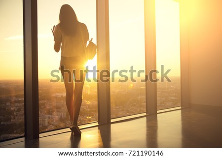Pretty woman posing on high floor building