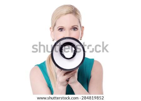 Pretty woman posing with loudhailer  - stock photo