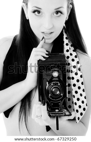 Pretty Woman posing with Vintage Camera - stock photo