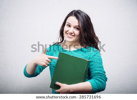 pretty woman showing a book - stock photo
