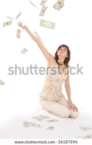 Pretty woman sitting among money - stock photo