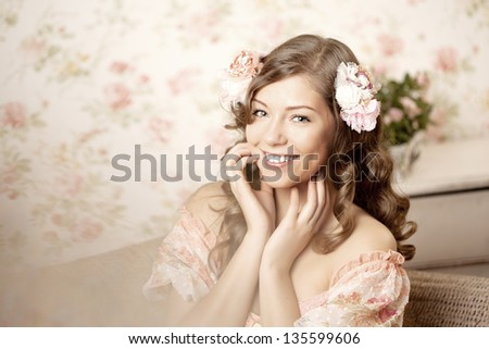 Pretty woman sitting in a room with a vintage interior - stock photo
