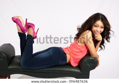 Pretty woman smiling and reclining