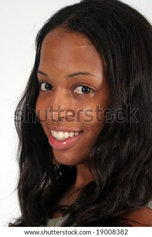 Pretty woman smiling at the camera - stock photo