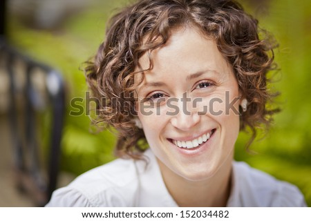 Pretty woman smiling at the park - stock photo