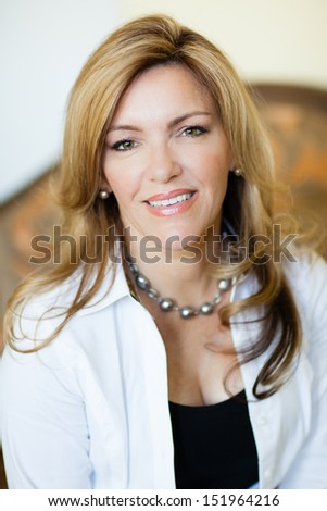 Pretty woman smiling looking at camera - stock photo