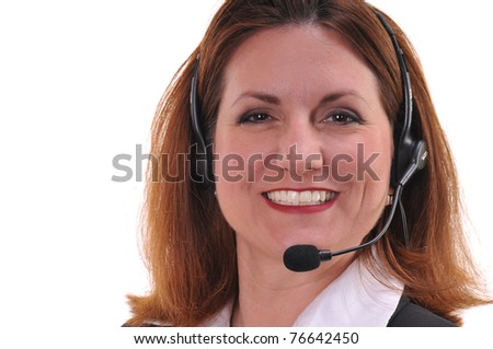 Pretty woman smiling, speaking to customers or constituents at a call center using a headset  - isolated over white background. - stock photo