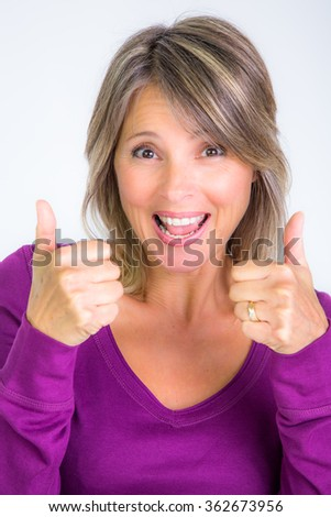 pretty woman smiling that says ok with inches - stock photo