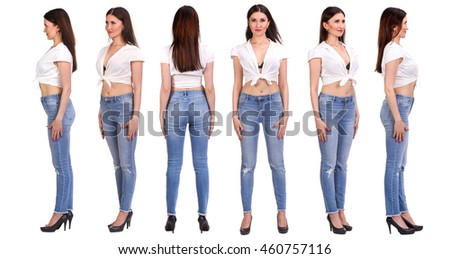 Pretty woman snaps in jeans isolated on white