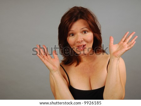 Pretty woman surprised and happy to see you - stock photo