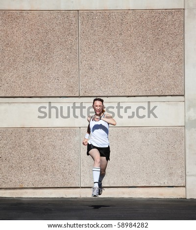 Pretty woman times herself running. - stock photo