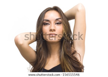 Pretty woman touching her hair with black shirt on white background