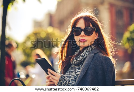 Ebook on ebook tablet pc concept stock illustration 147734750 pretty woman using tablet or ebook reader sitting in town street urban scene fandeluxe Ebook collections