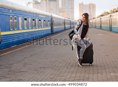 Pretty woman waiting at the train station