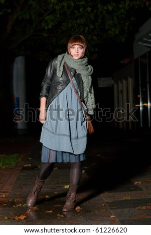 Pretty woman walking on the street  at night