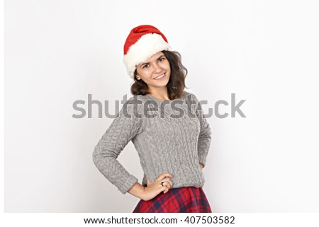 Pretty woman wearing christmas hat - stock photo