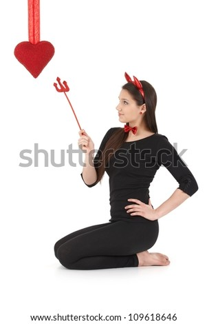 Pretty woman wearing devil costume at valentine's day. - stock photo
