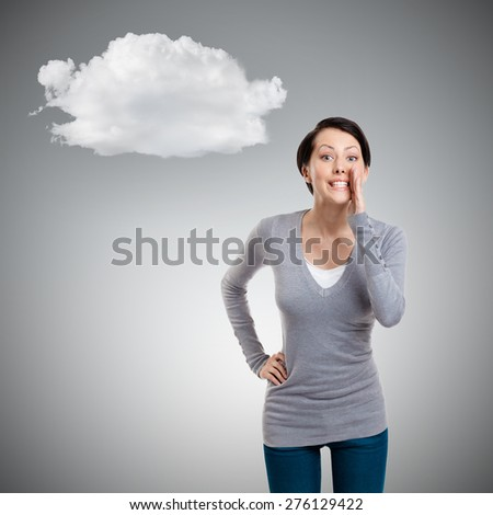 Pretty woman whispers, isolated on grey background - stock photo
