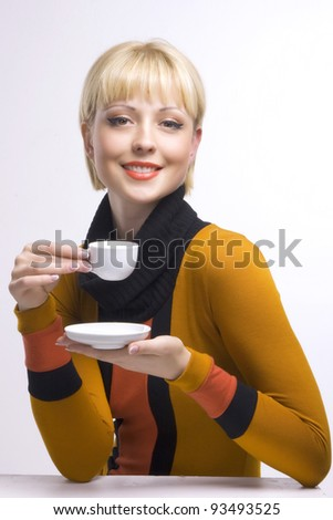 Pretty woman with a cup of coffee - stock photo