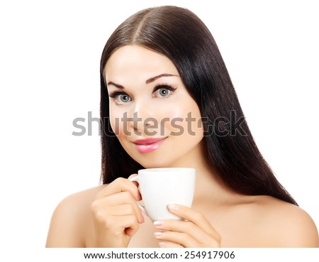 Pretty woman with a cup of tea or coffee, white background, isolated - stock photo