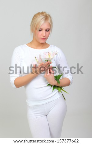 Pretty woman with a flower