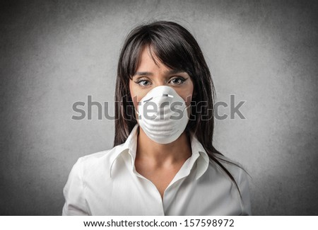 pretty woman with a mask on her face - stock photo
