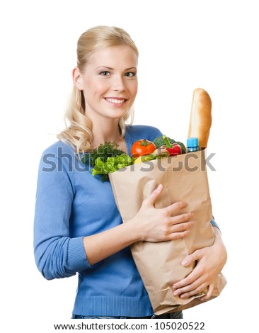 Pretty woman with a paper bag full of healthy eating, isolated on white