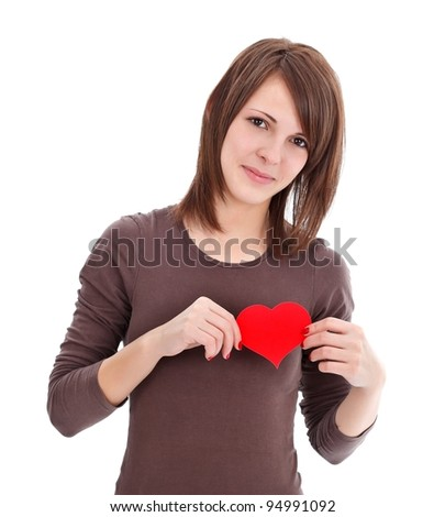 Pretty woman with a red paper heart in her hand