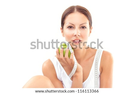 Pretty woman with apple and measure tape on white background - stock photo