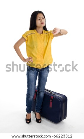 pretty woman with bag checking the time, isolated on white background - stock photo