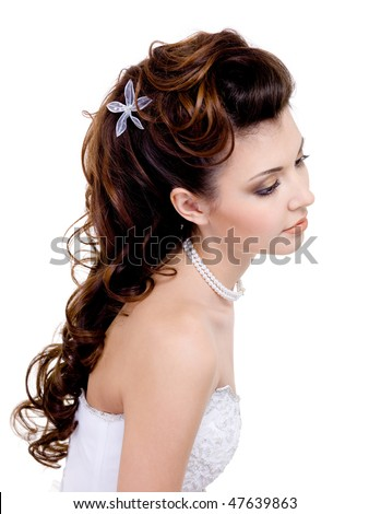 Pretty  woman with beautiful wedding hairstyle, long curly hairs - isolated on white - stock photo