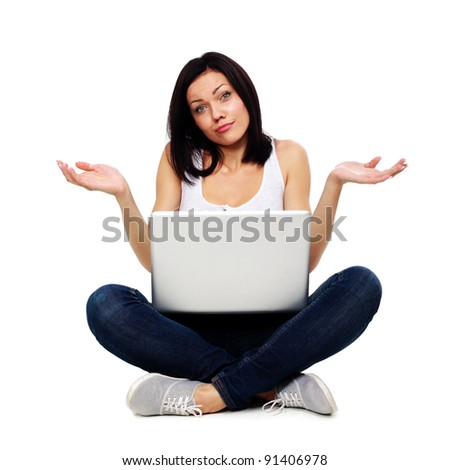Pretty woman with confused expression working on laptop - stock photo