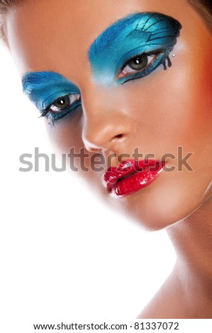 Pretty woman with creative makeup and body art