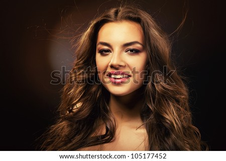 pretty woman with curls - stock photo