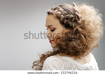 Pretty woman with curly hair - stock photo