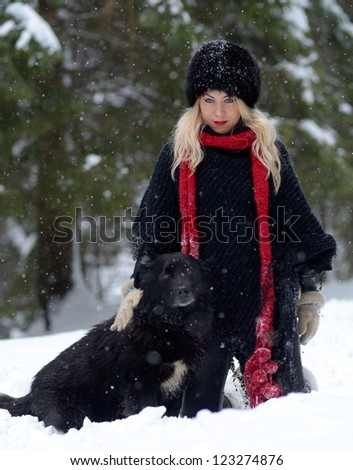 pretty woman with dog outdoor in winter